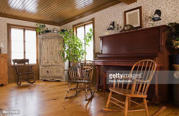 rocking chairs and piano in the living room of house - rocking chair stock pictures, royalty-free photos & images