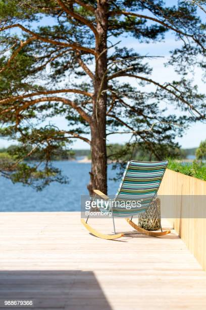 Rocking deckchair sits on a terrace looking out to the Baltic sea on SuperShe island near Raasepori, Finland, on Wednesday, June 27, 2018. The price...