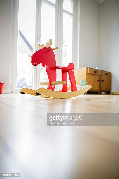 A rocking horse stands in a living room on August 12 2016 in Berlin Germany