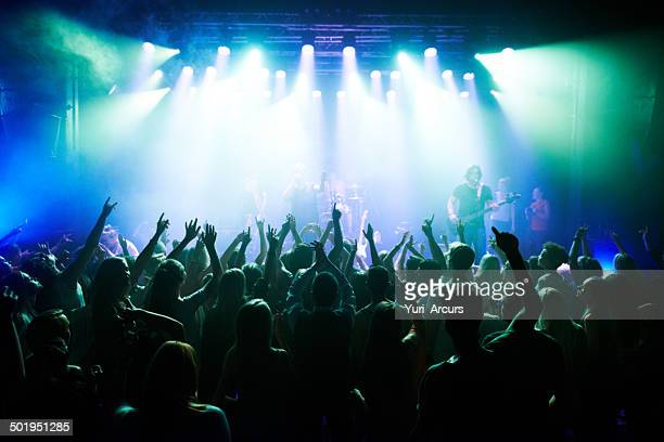 rocking out to their favourite band - club dj stock pictures, royalty-free photos & images