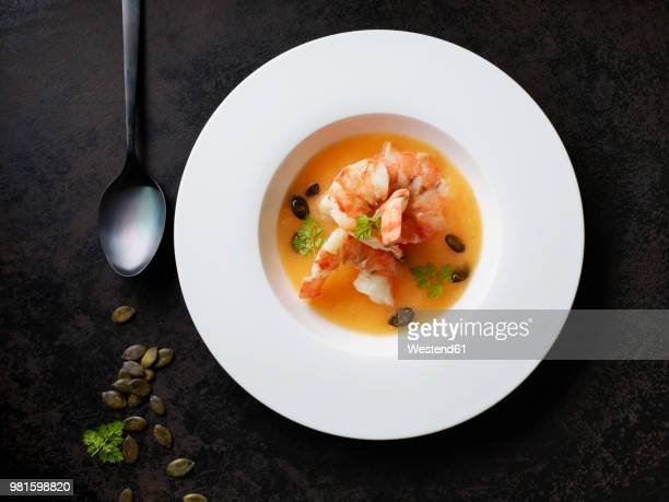 Rockmelon soup with prawns and caramelized pumpkin seeds