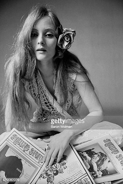 Rock'n'roll groupie Lacy reads Rolling Stone magazines at Belvedere Street Studio in San Francisco CA January 1968