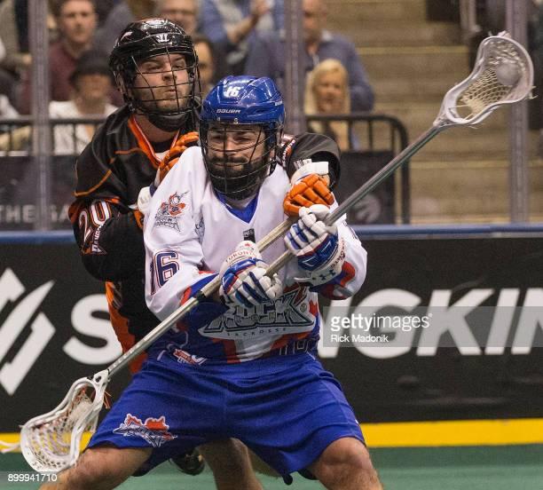 Rock's Adam Jones tied by Buffalo Bandits Nick Weiss Toronto Rock vs Buffalo Bandits in 1st half action of regular season play of National Lacrosse...