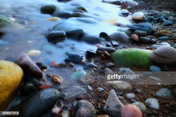 rocks along sea shore - rob castro stock pictures, royalty-free photos & images