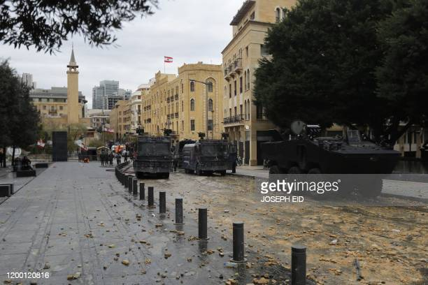 Rocks and debris cover a street in the Lebanese capital Beirut following a demonstration to stop a confidence vote for a new government, which they...