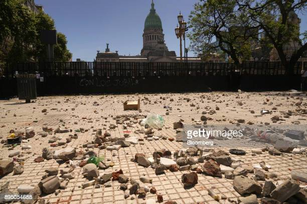 Rocks and debris lay on the floor after demonstrators clashed with police during protests against pension reforms in Buenos Aires Argentina on Monday...