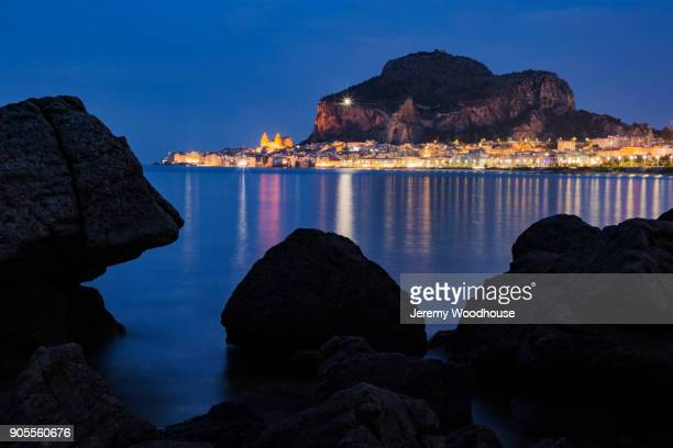 Rocks and distant cityscape at night