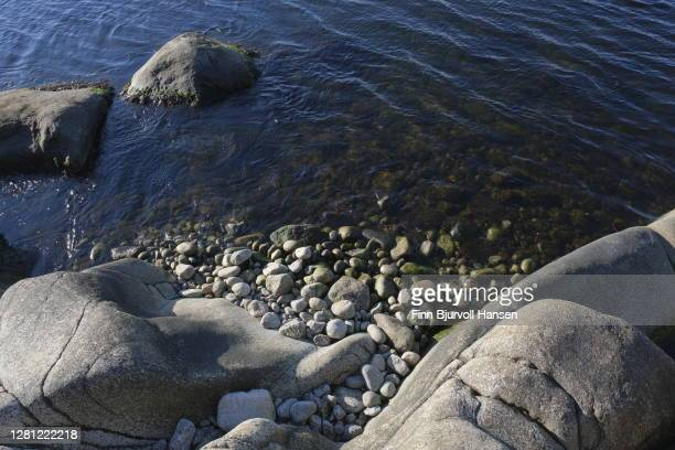 rocks and rocky small beach at the seashore - finn bjurvoll stock pictures, royalty-free photos & images