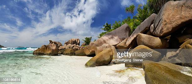 rocks and sea from anse cocos - tropical tree stock pictures, royalty-free photos & images