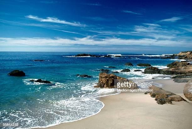 Rocks at a coastline of a sea, Bean Hollow Beach, Highway 1, California, USA