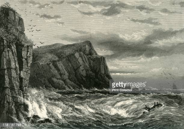 Rocks at Ilfracombe' circa 1870 Ilfracombe on the North Devon coast is a small harbour surrounded by cliffs From Picturesque Europe The British Isles...