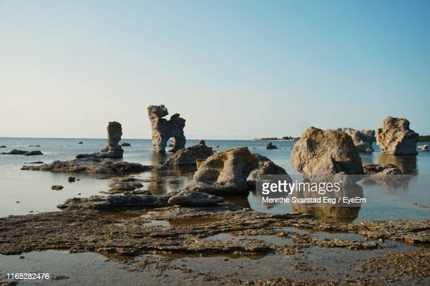 rocks at sea shore against sky - gotland stock pictures, royalty-free photos & images