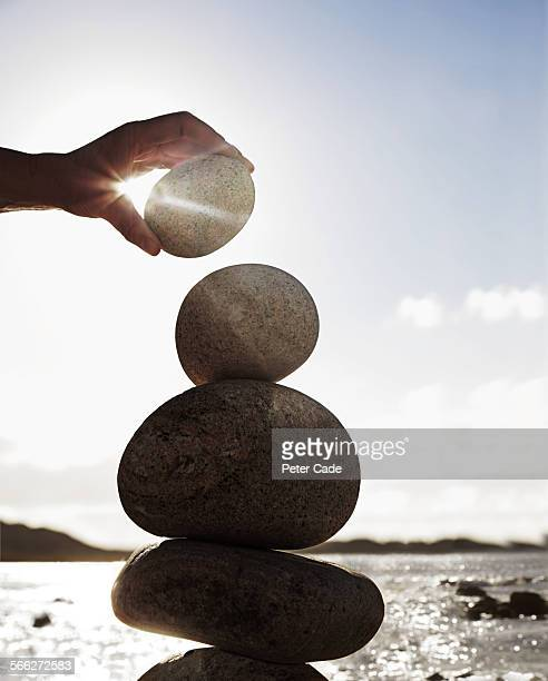 rocks being balanced on top of each other, beach .