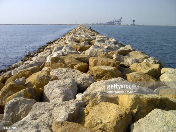 Rocks By Sea Against Clear Sky