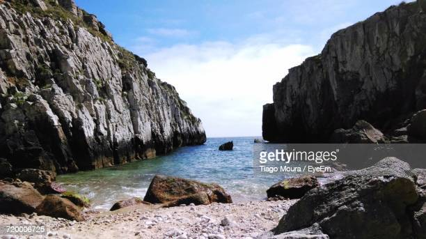 rocks by sea against sky - moura stock photos and pictures