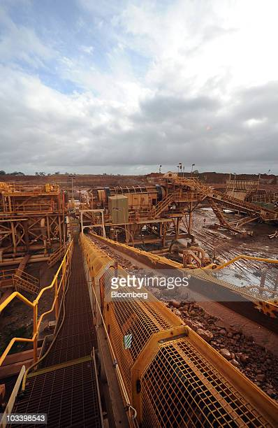 Rocks containing minerals travel down a conveyor belt in one of the earlier stages of separation at Iluka Resources Ltd's Douglas mineral sands...