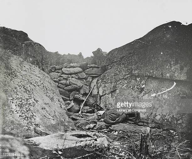 'Rocks could not save him' - a staged photograph of a Confederate sharpshooter lying behind a pile of rocks at Devil's Den, after the Battle of...