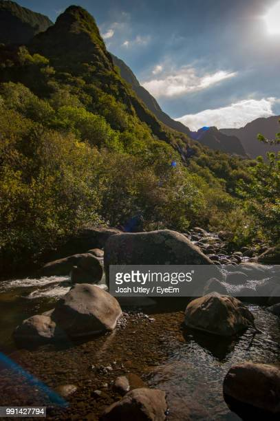 rocks in mountains against sky - josh utley stock pictures, royalty-free photos & images