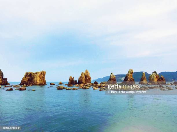 rocks in sea against sky - mie prefecture stock pictures, royalty-free photos & images