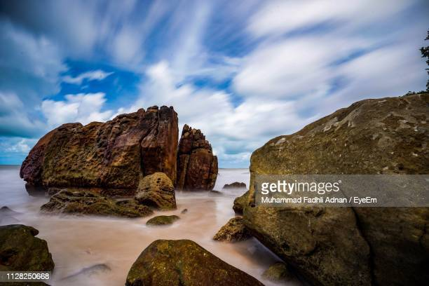 rocks in sea against sky - sarawak state stock pictures, royalty-free photos & images