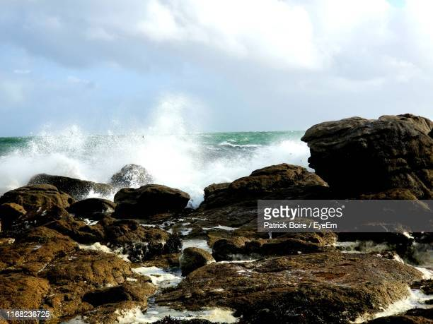rocks in sea against sky - france strike stock pictures, royalty-free photos & images
