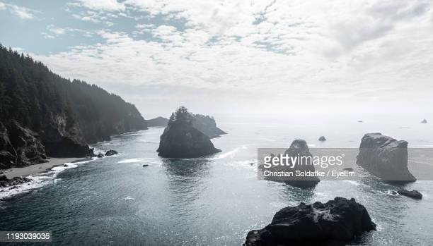rocks in sea against sky - christian soldatke stock pictures, royalty-free photos & images