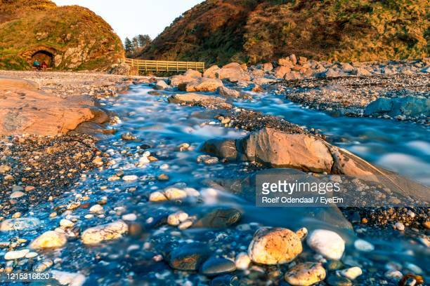 rocks in sea - isle of man stock pictures, royalty-free photos & images