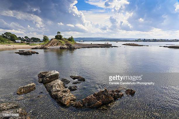 rocks in sea - daniele carotenuto stock-fotos und bilder