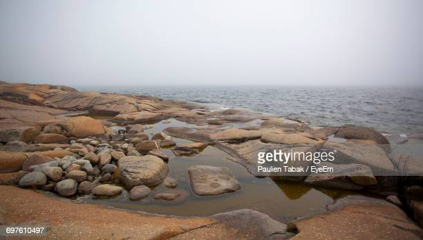 rocks in sea - paulien tabak stock pictures, royalty-free photos & images