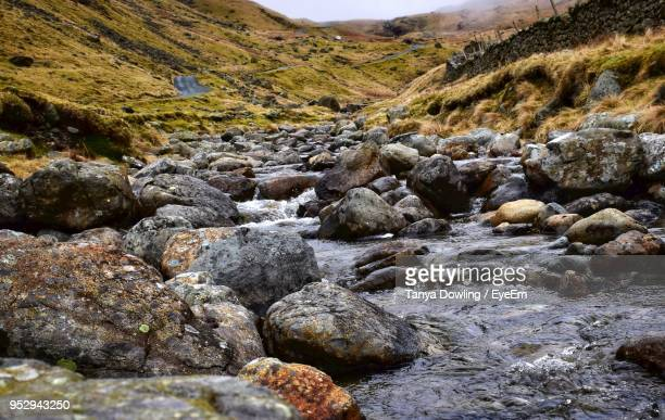 rocks in stream - barrow in furness stock photos and pictures