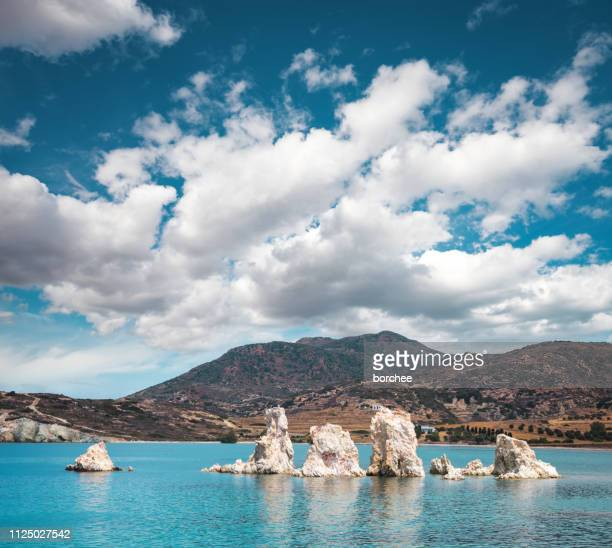 rocks in the sea - cyclades islands stock pictures, royalty-free photos & images