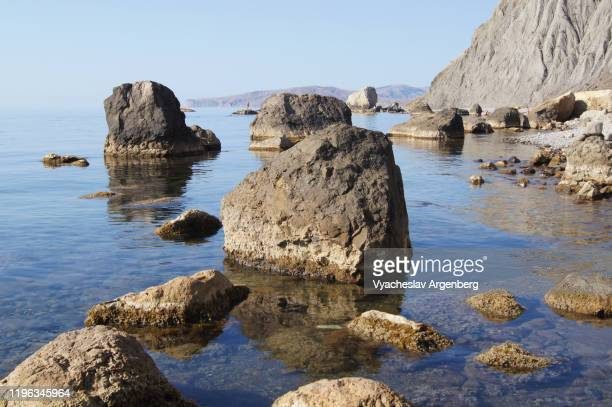 rocks in the sea, rocky coastline of black sea, crimea - argenberg stock pictures, royalty-free photos & images