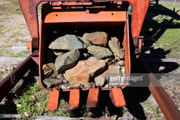 rocks inside a fork of abandoned old mining machinery - rafael ben ari fotografías e imágenes de stock