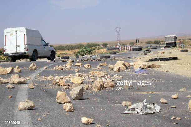 Rocks lay on the road on September 27 2012 in the Sidi Bouzid region where four football referees were taken hostage on September 26 as part of a...