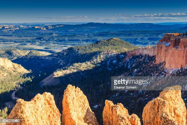 rocks lit by late afternoon sun with distant view in winter, paria view, bryce canyon national park, utah, united states of america, north america - paria canyon stock pictures, royalty-free photos & images