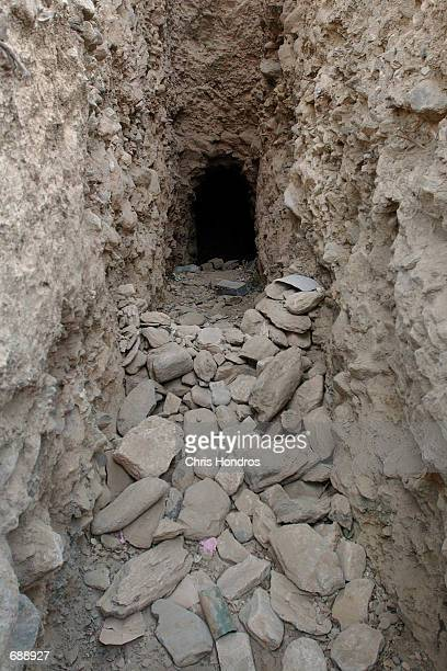 Rocks litter the entrance to a former AlQaeda cave December 24 2001 in Tora Bora Afghanistan AlQaeda soldiers hid in this and similar caves during...