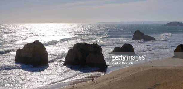 rocks of algarve coast at sunset - martial stock pictures, royalty-free photos & images