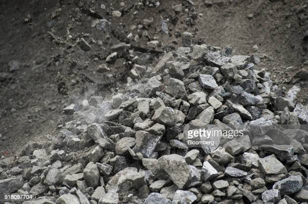 Rocks of raw aluminum ore are dropped onto a stockpile at the Northam Platinum Ltd Booysendal platinum mine outside the town of Lydenburg in...