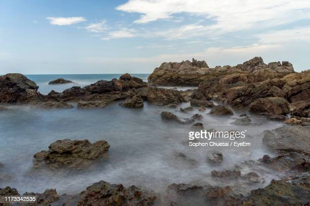 rocks on beach against sky - chanthaburi sea stock pictures, royalty-free photos & images