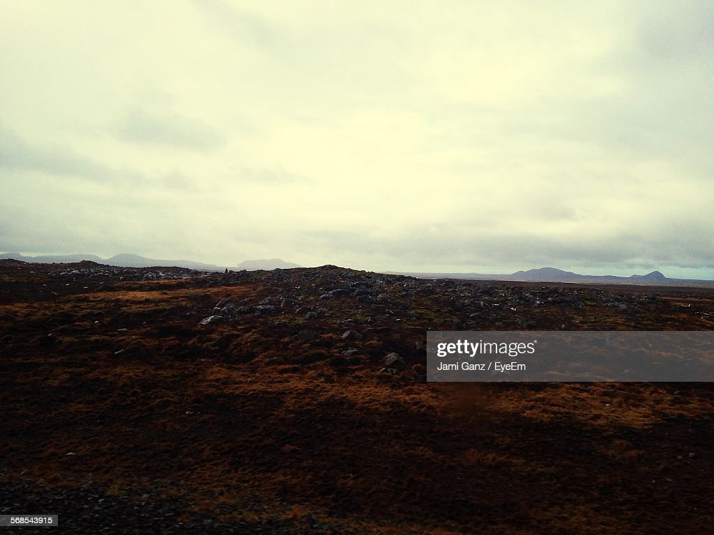 Rocks On Landscape Against Cloudy Sky : Stock Photo
