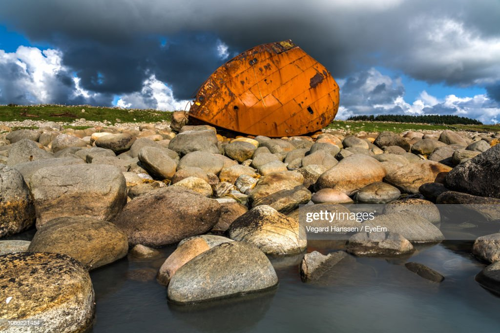 Rocks On Riverbank Against Sky : Stock Photo