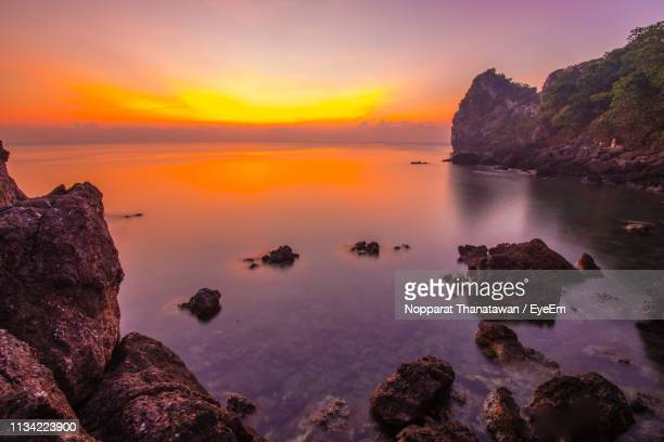 rocks on sea against sky during sunset - prachuap khiri khan province stock pictures, royalty-free photos & images
