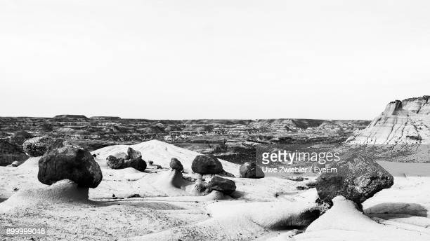 rocks on shore against clear sky - fossil site stock pictures, royalty-free photos & images