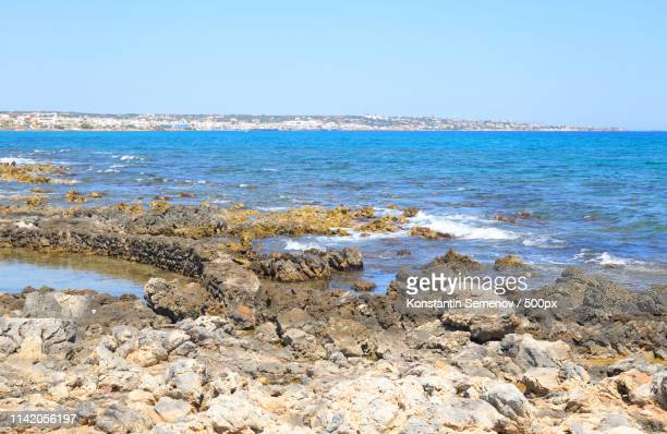 rocks on the coast of cretan sea - hersonissos photos et images de collection