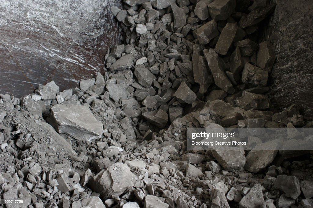 Rocks pass along the production line before being used to make cement : Stock Photo