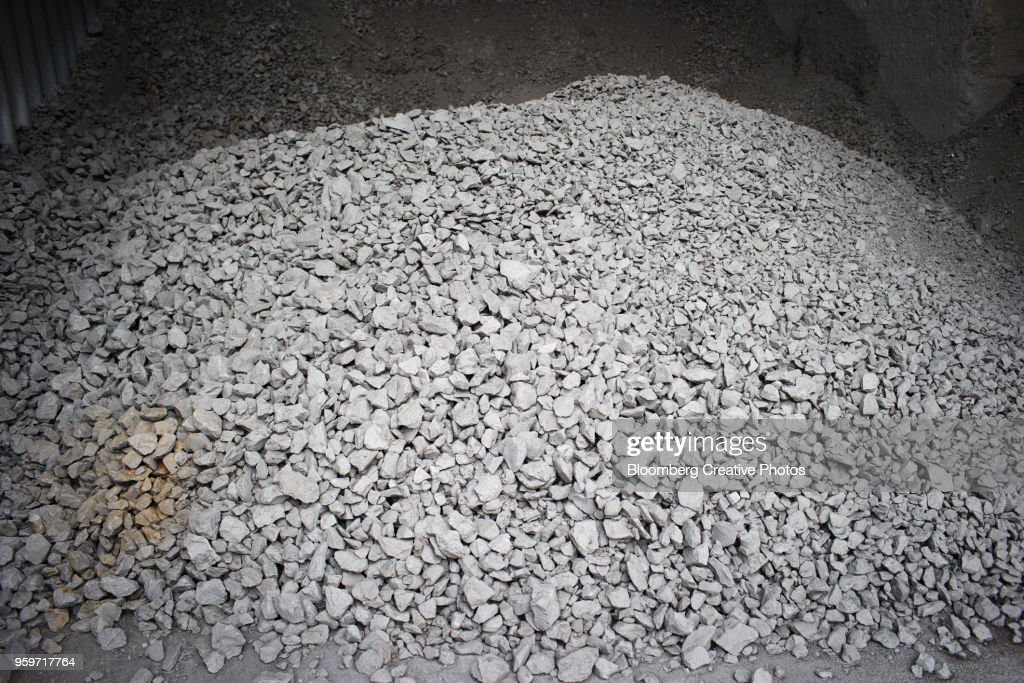 Rocks sit in stores before being used to make cement : Stock-Foto