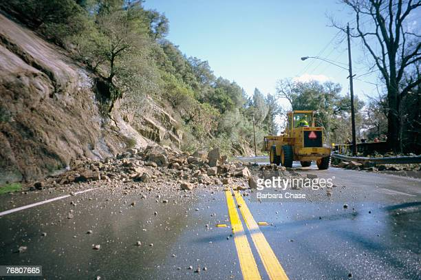 rockslide blocking highway - landslide stock pictures, royalty-free photos & images