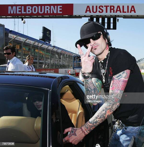 Rockstar Supernova drummer Tommy Lee steps into a Ferrari before going on a lap of the circuit with Scuderia Toro Rosso driver Scott Speed of the USA...