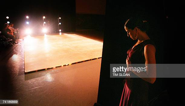 Pastora dancer Cecilia Terrasa takes a deep breath before stepping onstage for a performance during Pena Flamenca II 13 May 2007 at the American...