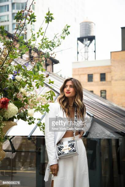 Rocky Barnes a fashion blogger poses for a photo during the 'Cinq A Sept' New York Fashion Week SS18 presentation at the Beekman Hotel in Manhattan...